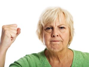 Angry senior shaking fist